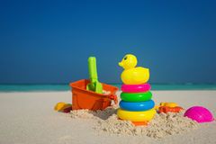Beach toys in the sand at the beach. Stock Photo