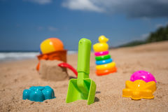 Beach toys in the sand at the beach.  Royalty Free Stock Photos
