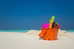 Beach toys in the sand at the beach.  Royalty Free Stock Photo
