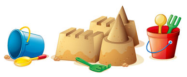 Beach toys and sand castle Royalty Free Stock Photo
