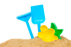 Beach toys in sand Royalty Free Stock Photo