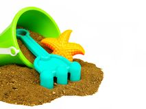 Beach toys and sand over white Royalty Free Stock Photos