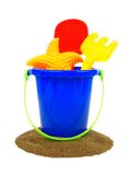 Beach toys with sand. Sand and pail with beach toys over a white background Royalty Free Stock Photography