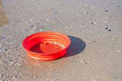 Beach toys in the sand and sea Stock Image