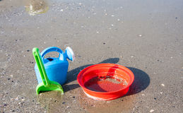 Beach toys in the sand and sea. Cesenatico Italy Royalty Free Stock Photos