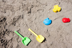 Beach toys in the sand and sea Stock Photos