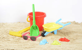 Beach Toys in the sand. And sunglasses Royalty Free Stock Image