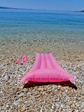Beach toys, slip on shoes on beach stock images