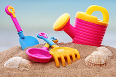 Beach toys. Summer beach toys in the sand Stock Images