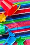 Beach toys on towel Stock Photo