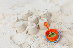 Beach toys on tropical beach. Colorful beach toys on white sand tropical beach Stock Photo