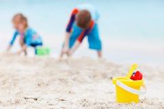 Beach toys on tropical beach Royalty Free Stock Image