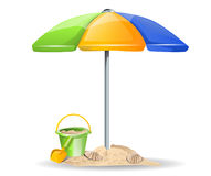 Beach toys and umbrella Royalty Free Stock Image