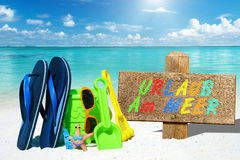 Beach toys and wooden signboard with text Stock Images