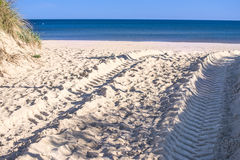 Beach with tracks Royalty Free Stock Image