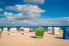 Beach with a traditional seats on the German North Sea island. Fohr royalty free stock images