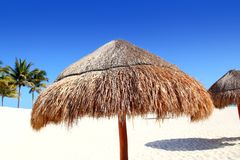 Beach traditional sunroof hut caribbean umbrellas Royalty Free Stock Photography