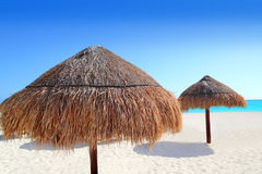 Beach traditional sunroof hut caribbean umbrellas Royalty Free Stock Image