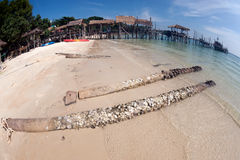 Beach and traditional wooden bridge. Royalty Free Stock Image