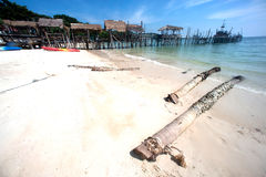 Beach and traditional wooden bridge. Stock Image