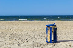 Beach trash can sea water waves landscape Stock Images