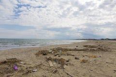 Beach with trash Royalty Free Stock Photos