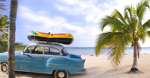 Beach travel. Detail of oldtimer parked on the sands of tropical beach
