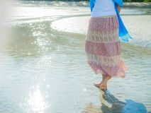 Beach travel - woman walking on sand beach. Closeup detail of female feet .Step up concept Royalty Free Stock Photo