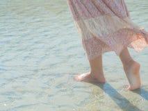 Woman walking on sand beach. Closeup detail of female feet . Beach travel - woman walking on sand beach. Closeup detail of female feet .Step up concept Stock Photos
