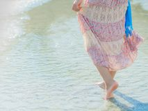 Woman walking on sand beach. Closeup detail of female feet . Beach travel - woman walking on sand beach. Closeup detail of female feet .Step up concept Royalty Free Stock Images