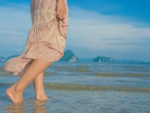 Woman walking on sand beach. Closeup detail of female feet .Step up concept. Beach travel - woman walking on sand beach. Closeup detail of female feet .Step up Royalty Free Stock Photography