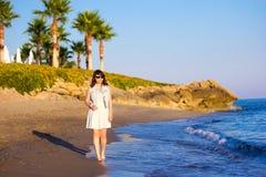 Beach travel - woman walking on sandy beach Stock Photos