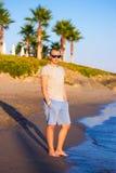 Beach travel - young man posing on sandy beach Stock Image