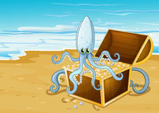 A beach with a treasure box with an octopus Stock Photo