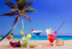 Beach tropical cocktails on white sand mojito blue hawaii stock photos