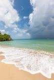 Beach on tropical island. Clear blue water, sand Stock Photos
