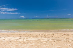 Beach on tropical island. Clear blue water, sand Stock Images