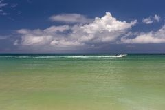Beach on tropical island. Clear blue water and sky Royalty Free Stock Photography