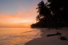 The beach on the tropical island. Dawn. Indonesia. Indian Ocean. Stock Photo