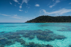 Beach on the tropical island with green water. Blue sky, koh rok of Thailand Royalty Free Stock Photo