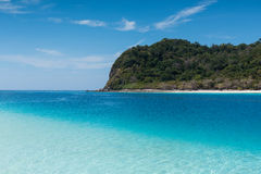 Beach on the tropical island with green water. Blue sky, koh rok of Thailand Stock Photo