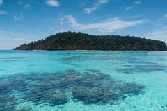 Beach on the tropical island with green water. Blue sky, koh rok of Thailand Royalty Free Stock Photography