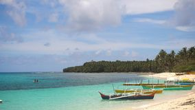 Beach on a tropical island. Philippines,Siargao. Beach with white sand and palm trees on a tropical island. Seascape ocean and beautiful beach paradise, Siargao Stock Images