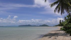 Beach of tropical island. Seascape calm sea white sand palm trees. Thailand stock video footage