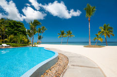 Beach with tropical pool Stock Photos