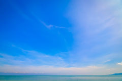 Beach and tropical sea. On blue sky background Stock Photography