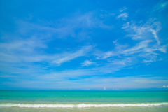Beach and tropical sea. On blue sky background Stock Image