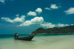 Beach and tropical sea with long-tail boat Stock Images