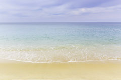 Beach and tropical sea. With soft wave on sandy beach Royalty Free Stock Image