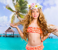 Beach tropical vacation kid blond girl with fashion flowers. In head and palm tree Royalty Free Stock Photo